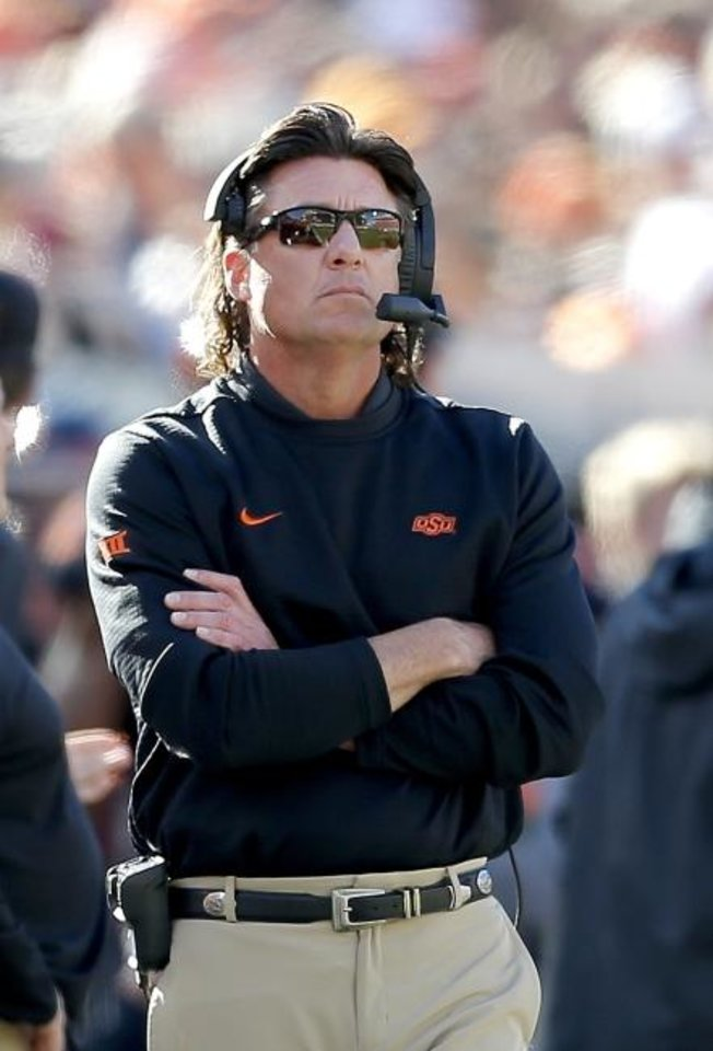Photo -  Oklahoma State coach Mike Gundy has made it clear: A big key to beating Oklahoma on Saturday at Boone Pickens Stadium will be stopping Sooners quarterback Jalen Hurts. [Sarah Phipps/The Oklahoman]