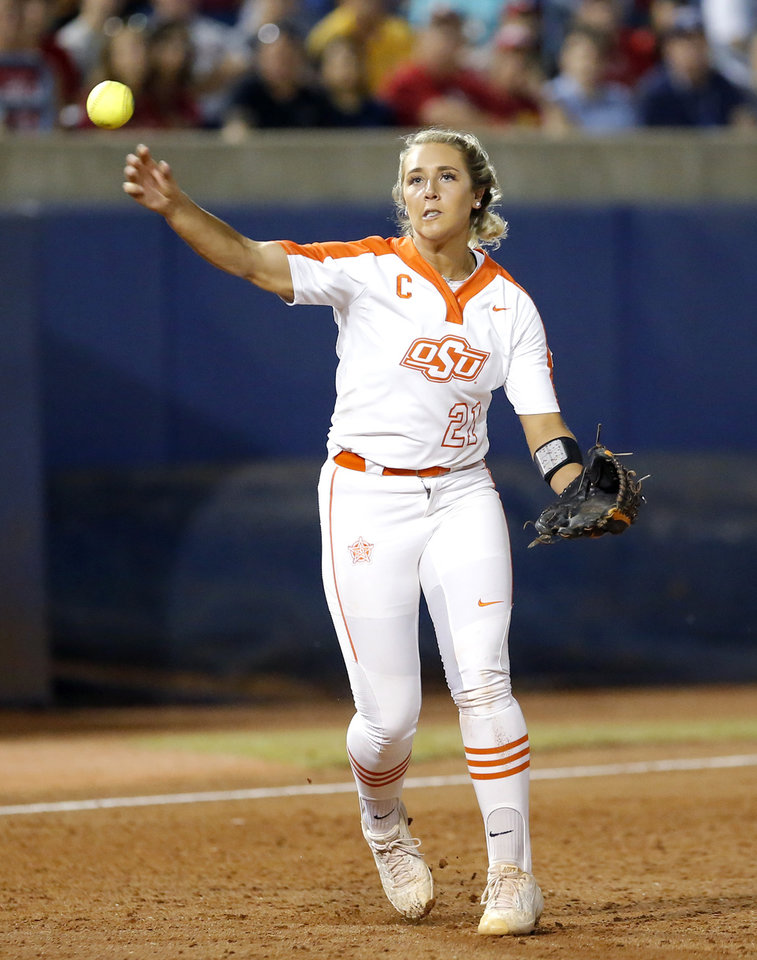 Photo - Oklahoma State's Sydney Pennington (21) throws to first during a Women's College World Series between Oklahoma State (OSU) and Oklahoma at USA Softball Hall of Fame Stadium in Oklahoma City,  Friday, May 31, 2019.  [Sarah Phipps/The Oklahoman]