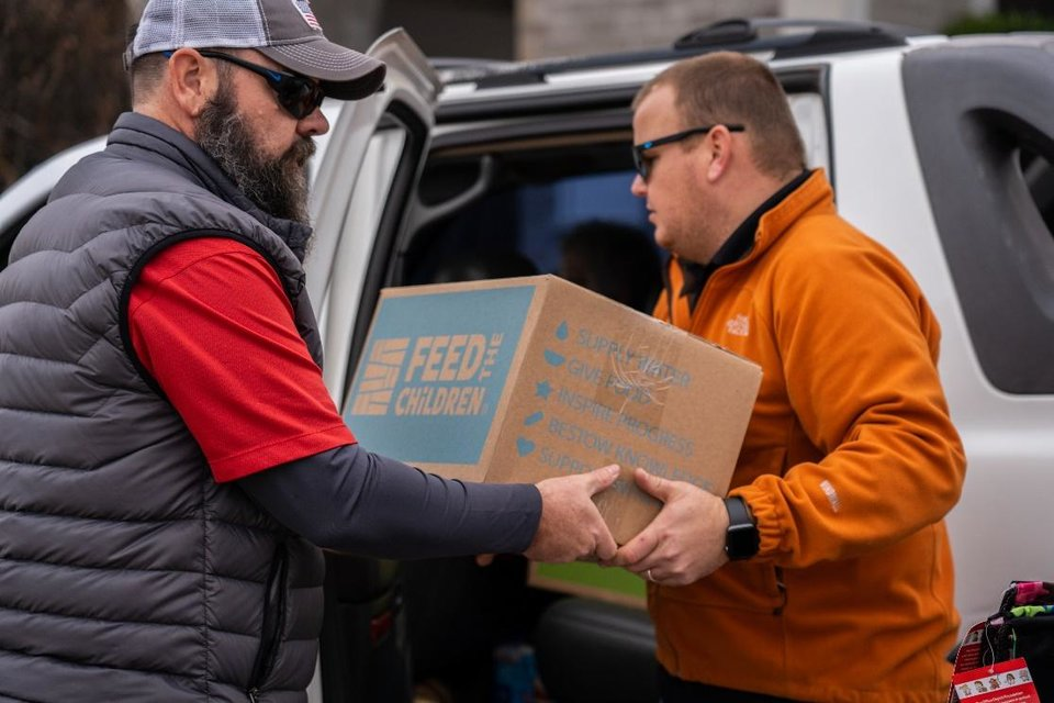 Photo - Volunteers provide the fuel that drives Feed the Children. [PHOTO PROVIDED]