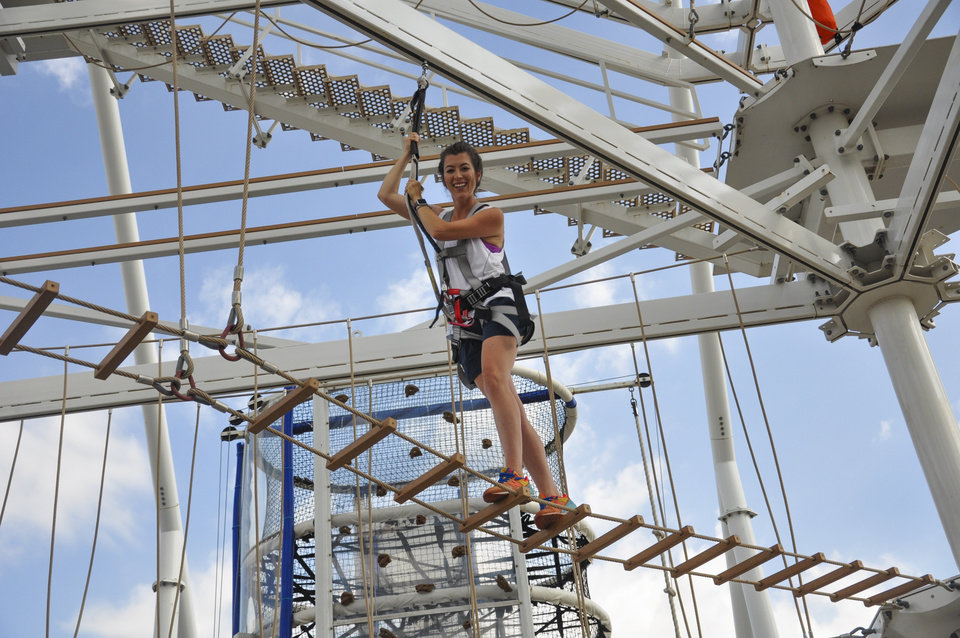 Photo -  A woman gets set to take a ride on a zip line at Riversport OKC. [Provided by Georgia Read]