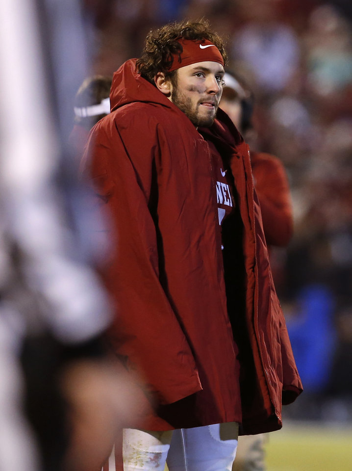 Photo - Oklahoma's Baker Mayfield watches from the sideline during Saturday's game against TCU at Gaylord Family-Oklahoma Memorial Stadium in Norman. Mayfield has passed concussion tests, though his availability against Oklahoma State next Saturday is uncertain. (Photo by Bryan Terry, The Oklahoman)