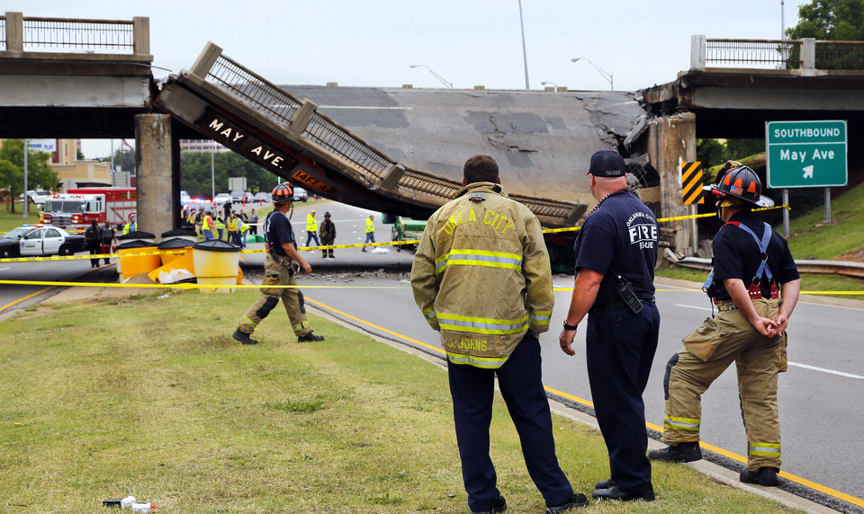 Photo - A section of the May Ave. bridge above the Northwest Expressway collapsed when  it was hit by a truck Thursday afternoon, in  Oklahoma City. No injuries were reported. Photo by Jim Beckel, The Oklahoman.