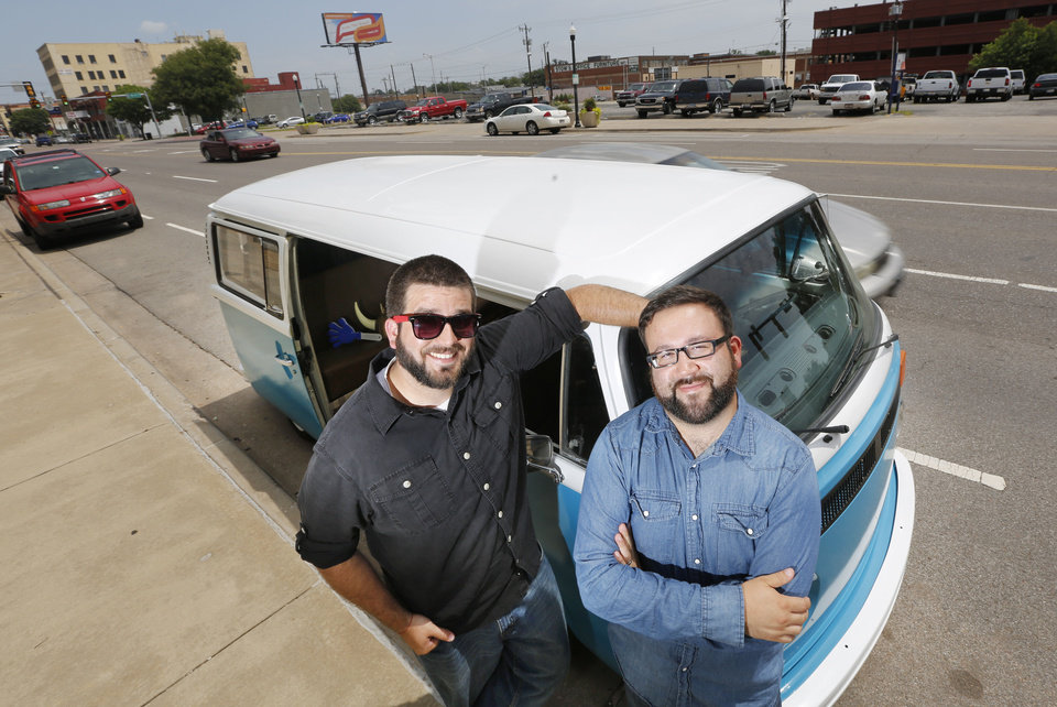 Photo - Instabus owners Richard Gonzales, left, and Josh Fisher pose for photos with their Volkswagen bus in Oklahoma City. Gonzales and Fisher turned the Volkswagen into a mobile photo booth. Photo By Steve Gooch, The Oklahoman  Steve Gooch - The Oklahoman
