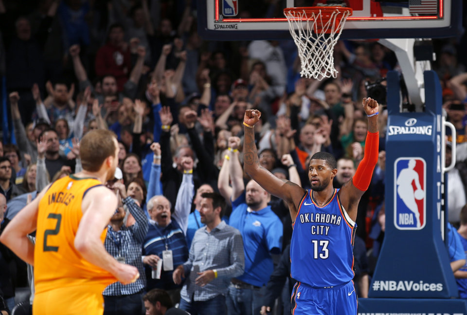 Photo - Oklahoma City's Paul George (13) celebrates in front of Utah's Joe Ingles (2) in the double overtime NBA game between the Oklahoma City Thunder and the Utah Jazz at the Chesapeake Energy Arena, Friday, Feb. 22, 2019. Photo by Sarah Phipps, The Oklahoman