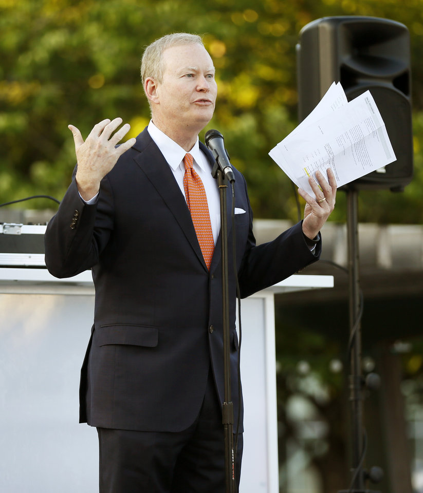 Photo - Mayor Mick Cornett speaks during the OKC Welcome Reception Celebration at the Myriad Botanical Gardens during the Southern Republican Leadership Conference in downtown Oklahoma City, Thursday, May 21, 2015. Photo by Nate Billings, The Oklahoman