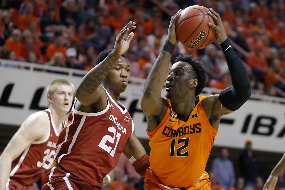 Photo - Oklahoma State's Cameron McGriff (12) tries to get past Oklahoma's Kristian Doolittle (21) during an NCAA men's Bedlam basketball game between the Oklahoma State University Cowboys (OSU) and the University of Oklahoma Sooners (OU) at Gallagher-Iba Arena in Stillwater, Okla., Saturday, Feb. 22, 2020. Oklahoma State won 83-66. [Bryan Terry/The Oklahoman]