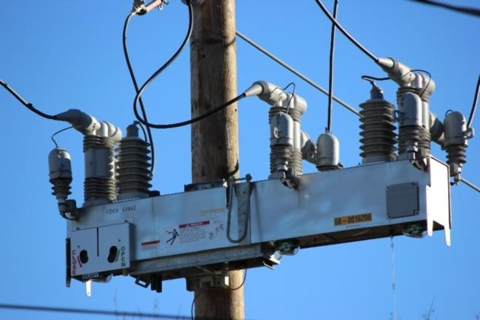 Photo -  An Intellirupter is shown that has been installed by OG&E on one of its Arkansas circuits. The device is a communicating switch that enables the utility to automatically isolate faults remotely and to reroute power to keep the lights on for as many customers as possible. [PROVIDED BY OKLAHOMA GAS & ELECTRIC CO.]