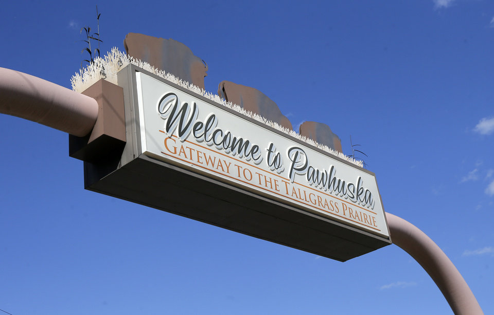 Photo -  A sign over Kihekah Avenue welcomes travelers to Pawhuska, the county seat of Osage County and the capitol of the Osage Nation. [Photo by Nate Billings, The Oklahoman]