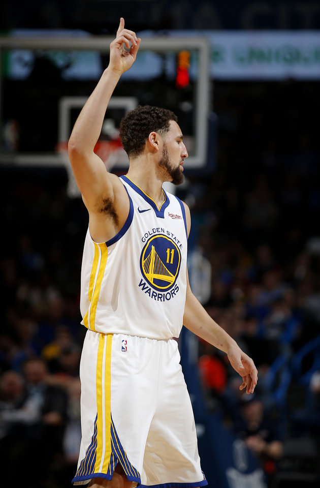 Photo - Golden State's Klay Thompson (11) reacts after a basket during the NBA basketball game between the Oklahoma City Thunder and the Golden State Warriors at Chesapeake Energy Arena,  Saturday, March 16, 2019. Photo by Sarah Phipps, The Oklahoman