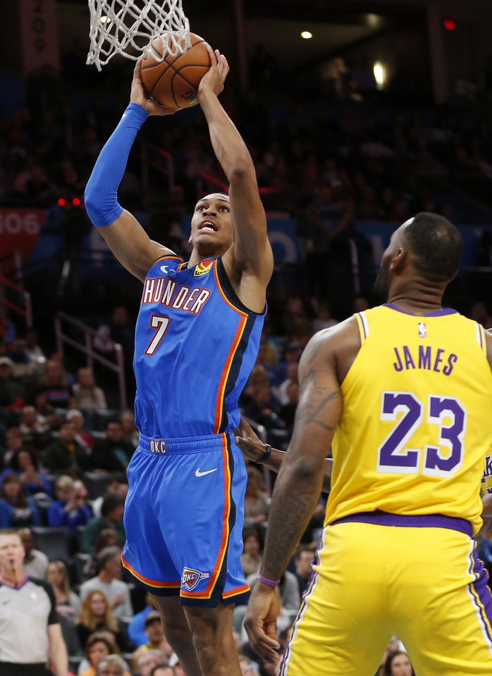 Photo - Oklahoma City's Darius Bazley (7) takes the ball to the basket near Los Angeles' LeBron James (23) in the second quarter during an NBA basketball game between the Oklahoma City Thunder and the Los Angeles Lakers at Chesapeake Energy Arena in Oklahoma City, Friday, Nov. 22, 2019. [Nate Billings/The Oklahoman]