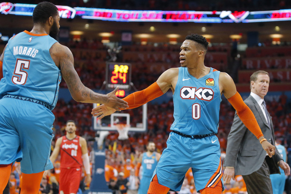 Photo - Oklahoma City's Russell Westbrook (0) celebrates with Markieff Morris (5)  in front of Portland coach Terry Stotts during Game 3 in the first round of the NBA playoffs between the Portland Trail Blazers and the Oklahoma City Thunder at Chesapeake Energy Arena in Oklahoma City, Friday, April 19, 2019. Photo by Bryan Terry, The Oklahoman