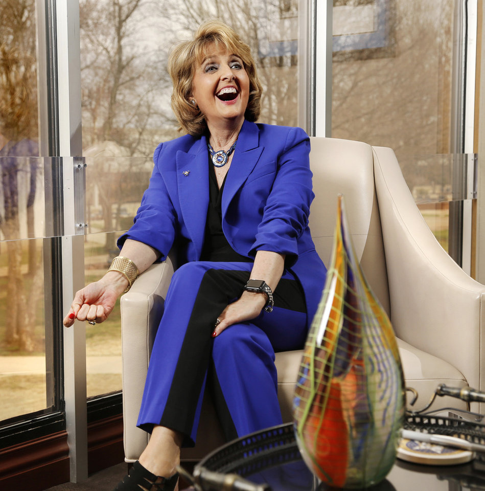 Photo -  Jeanie Webb shares a laugh in her office at Rose State College. [JIM BECKEL/THE OKLAHOMAN]