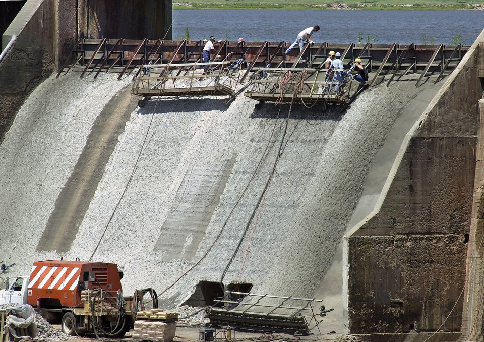 Invest in dam rehabilitation news ok close closing workers at the middle of the dam overholser lake dam is sciox Image collections
