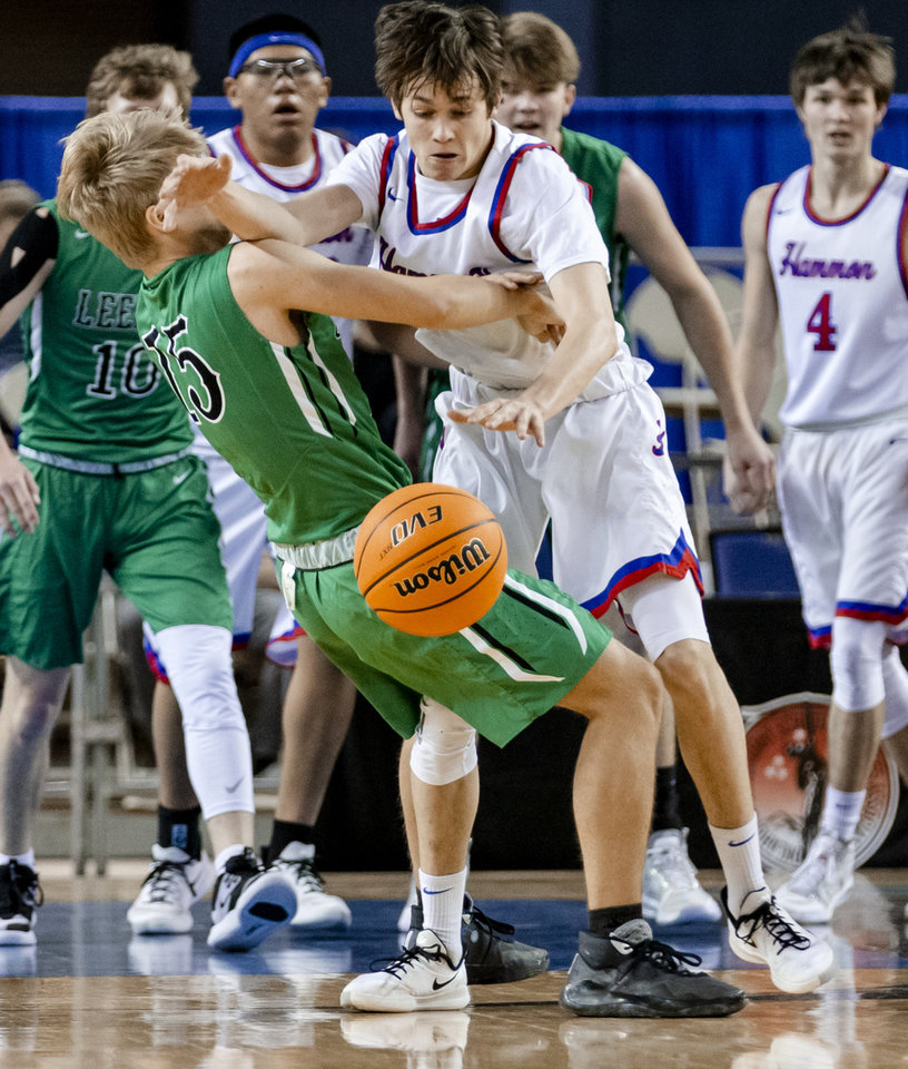 Photo - Leedey's Parker Ward (15) collies with Hammon's Peyton Osmond (10) during a Class B boys state tournament semi-final basketball game between Hammon vs Leedey in the Jim Norick Arena at State Fair Park in Oklahoma City, Okla. on Friday, March 6, 2020.  [Chris Landsberger/The Oklahoman]