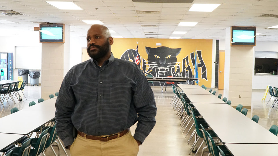 Photo -  R.L. Vick is the principal at Okemah High School and was formerly a police officer in Muskogee. [Photo by Dave Morris, The Oklahoman]