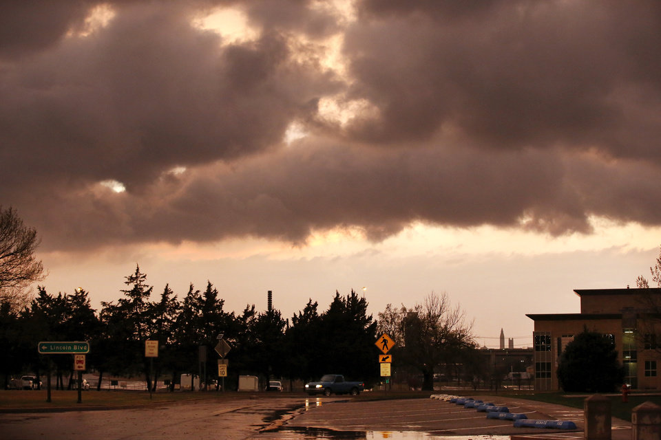 Photo - Storm clouds darken the skies over north Oklahoma City on Wednesday evening, March 25, 2015. Photo by Jim Beckel, The Oklahoman