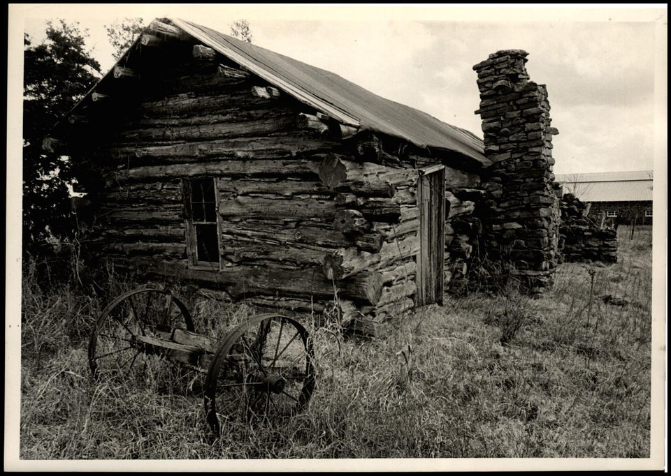 Photo -  This cabin at Pawnee, shown in a 1962 photo, was Pawnee Bill's first home after he came to Indian Territory. [THE OKLAHOMAN ARCHIVES]