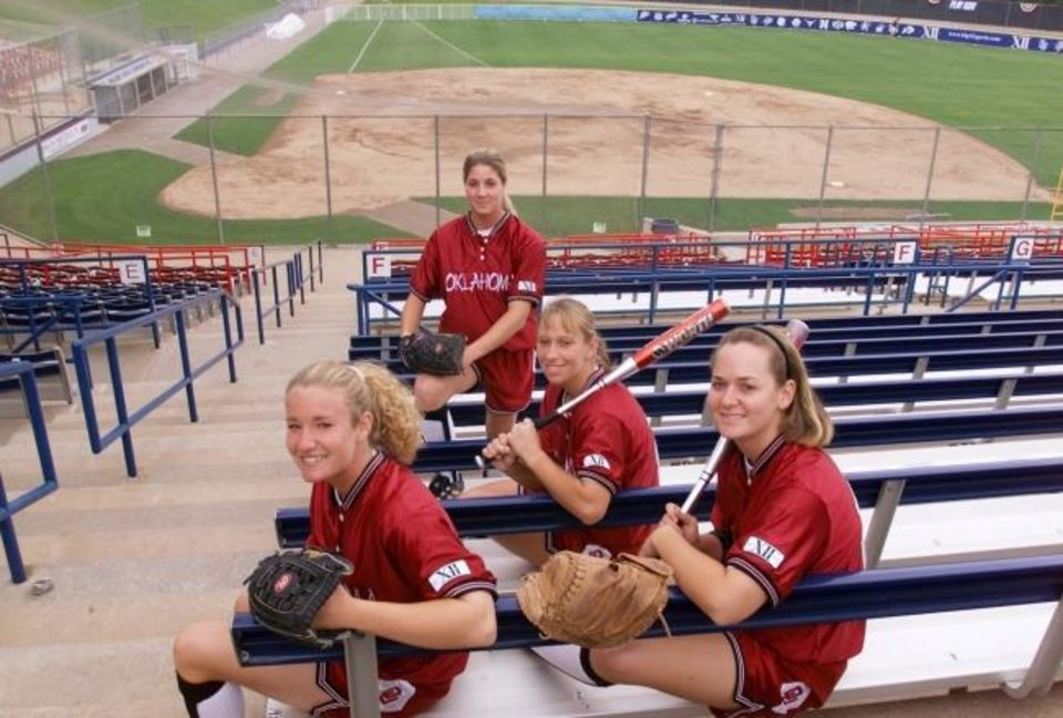 Photo -  OU softball players Lana Moran, Ashli Barrett (front), Lisa Carey (middle) and Jennifer Stewart (rear) pose for a photo before the Sooners' WCWS-title run in 2000. [OKLAHOMAN ARCHIVES]