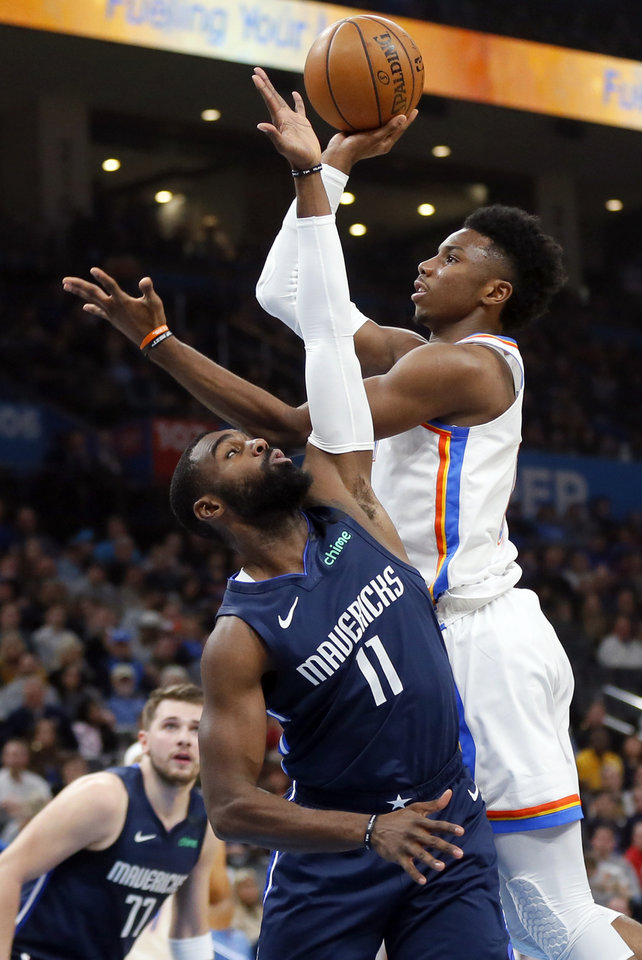 Photo - Oklahoma City's Hamidou Diallo (6) shoots next to Dallas' Tim Hardaway Jr. (11) in the first quarter during an NBA basketball game between the Oklahoma City Thunder and Dallas Mavericks at Chesapeake Energy Arena in Oklahoma City, Monday, Jan. 27, 2020. [Nate Billings/The Oklahoman]