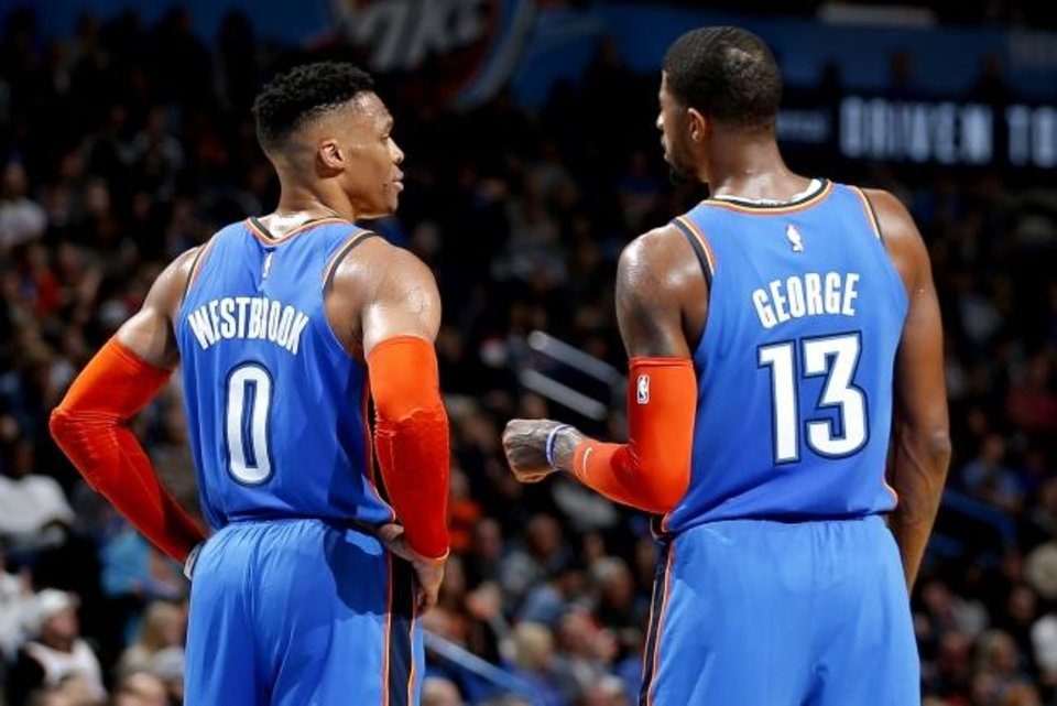 Photo -  Thunder coach Billy Donovan has the support of stars Russell Westbrook (0) and Paul George (13). [Sarah Phipps/The Oklahoman]