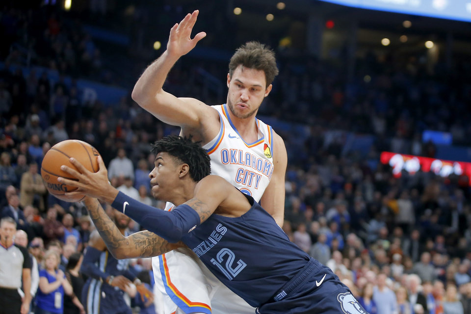 Photo - Memphis' Ja Morant (12) goes past Oklahoma City's Danilo Gallinari (8) during an NBA basketball game between the Oklahoma City Thunder and the Memphis Grizzlies at Chesapeake Energy Arena in Oklahoma City, Wednesday, Dec. 18, 2019. [Bryan Terry/The Oklahoman]