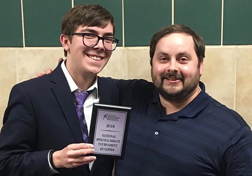 Photo -  Payton Woolard, left, will be competing in June at the National Speech and Debate Association national tournament. Woolard is pictured with his debate coach, Michael Ferguson. [PHOTO PROVIDED]