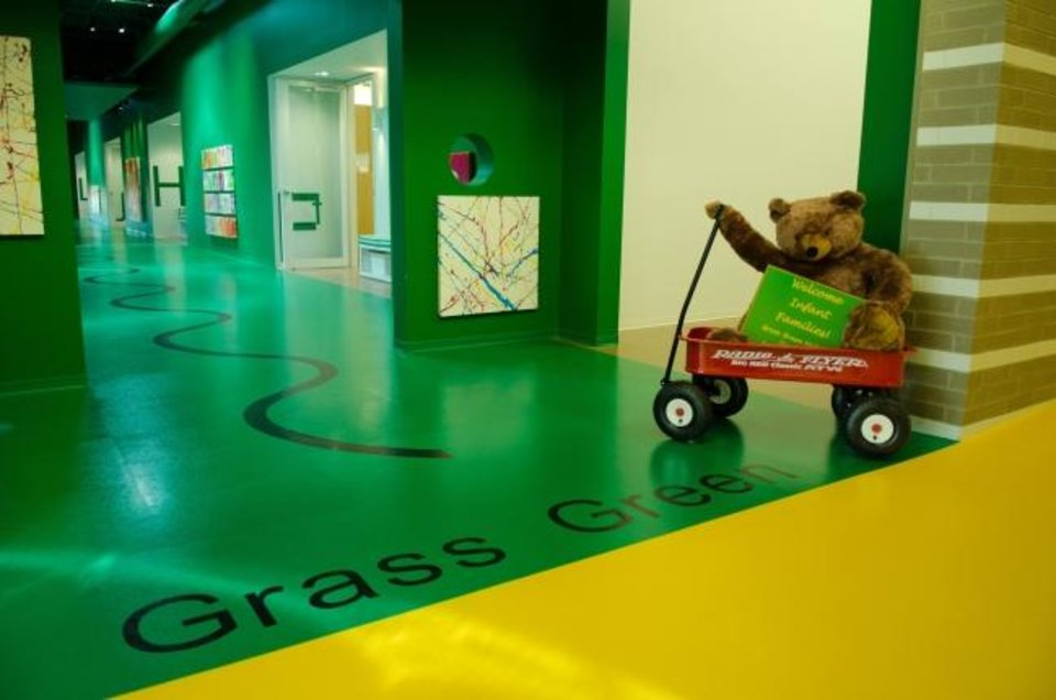 Photo -  A wagon-riding bear welcomes guests to a recent open house at Chesapeake Energy's child development center. [PROVIDED BY CHESAPEAKE ENERGY]