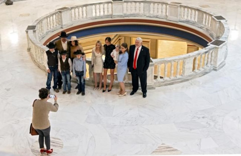 Photo -  Family members pose for photos during the swearing in ceremony for new and re-elected Oklahoma senators at the Oklahoma state Capitol in Oklahoma City, Okla. on Monday, Nov. 16, 2020. [Chris Landsberger/The Oklahoman]