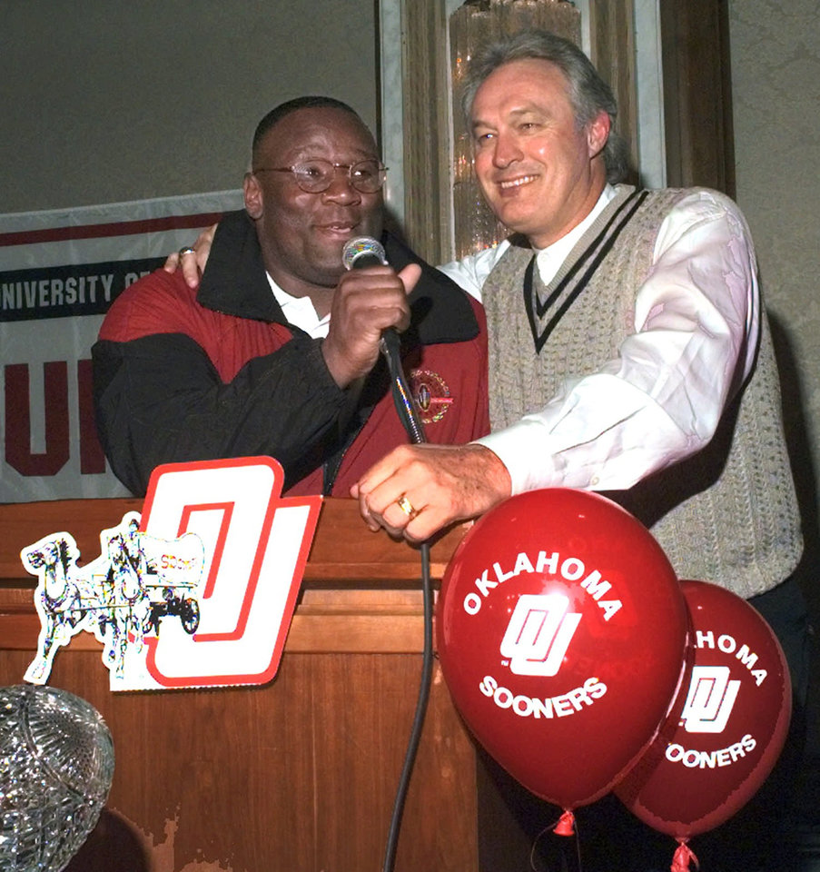Photo - OU VS NORTHWESTERN (PIGSKIN CLASSIC)--OU HEAD COACH JOHN BLAKE AND ATHLETIC DIRECTOR STEVE OWENS ADDRESS AN ENTHUSIASTIC CROWD OF OU FANS GATHERED AT A DOWNTOWN CHICAGO HOTEL FOR A PEP RALLY THURSDAY NIGHT.