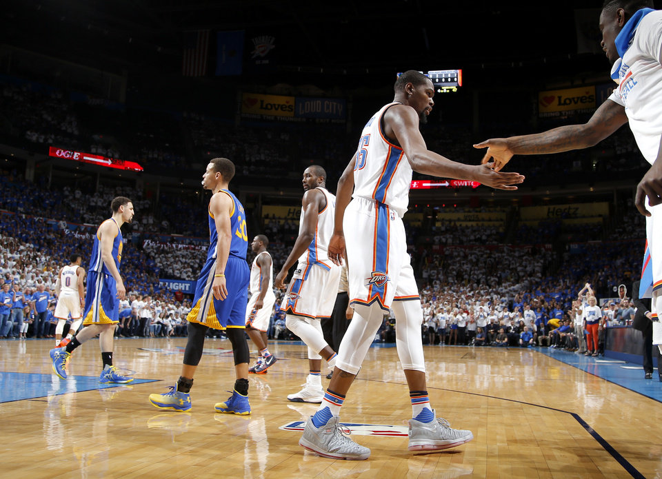 Photo - Oklahoma City's Kevin Durant (35) slaps hands after a basket during Game 3 of the Western Conference finals in the NBA playoffs between the Oklahoma City Thunder and the Golden State Warriors at Chesapeake Energy Arena in Oklahoma City, Sunday, May 22, 2016. Photo by Bryan Terry, The Oklahoman