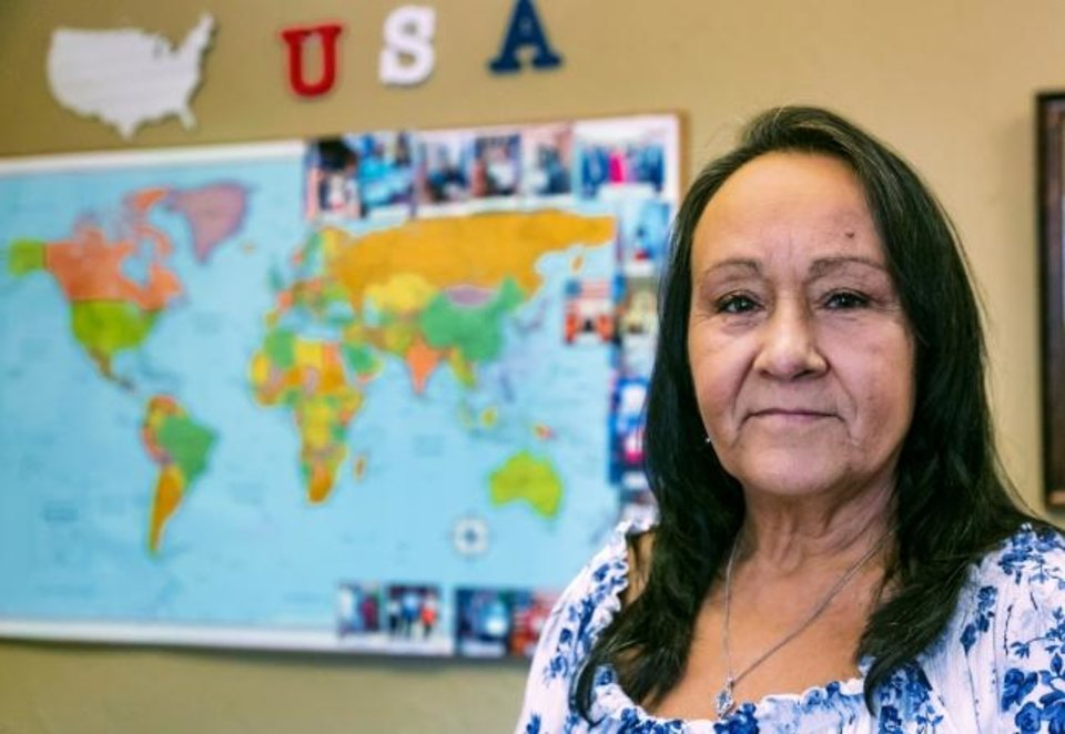 Photo -  Zoila Rivero, a Cuban native, is shown at the Immigration Center at The Fellowship at Western Oaks Church of the Nazarene in Oklahoma City, an organization that helped her obtain her U.S. citizenship in March.  [Chris Landsberger/The Oklahoman]