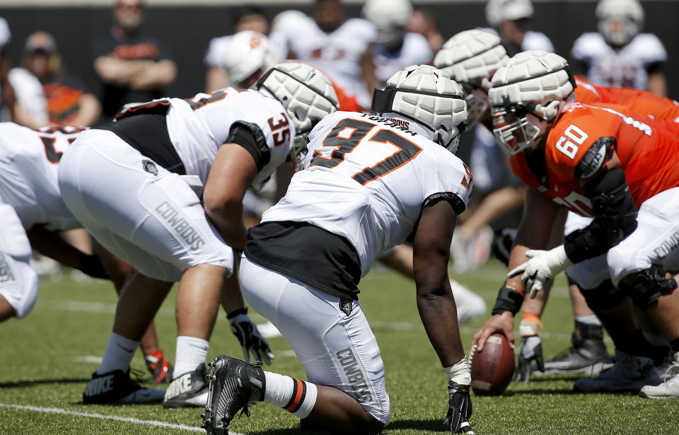 Photo - Oklahoma State's Amadou Fofana (97) and   Samuela Tuihalamaka line up during the Oklahoma State Cowboys spring practice at Boone Pickens Stadium in Stillwater, Okla., Saturday, April 20, 2019.  Photo by Sarah Phipps, The Oklahoman