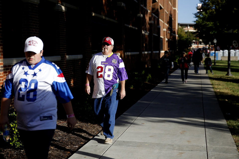 Photo - Fans walk outside the stadium before a college football game between the University of Oklahoma Sooners (OU) and the West Virginia Mountaineers at Gaylord Family-Oklahoma Memorial Stadium in Norman, Okla, Saturday, Oct. 19, 2019. [Bryan Terry/The Oklahoman]