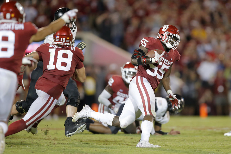 Photo - Oklahoma's Kenneth Mann (55) intercepts a pass in the fourth quarter during a college football game between the University of Oklahoma Sooners (OU) and the Army Black Knights at Gaylord Family-Oklahoma Memorial Stadium in Norman, Okla., Saturday, Sept. 22, 2018. Photo by Bryan Terry, The Oklahoman