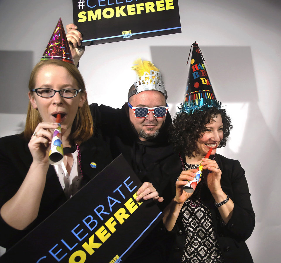 Photo - Megan Flynn, with Free the Night; Greg and Jennifer Seals, co-owners of Grandad's, celebrate Monday the success of a campaign to get bars and clubs in Oklahoma to voluntarily go smoke-free. A recent survey shows most respondents prefer smoke-free bars and clubs.  Photo by Jim Beckel, The Oklahoman  Jim Beckel -  THE OKLAHOMAN