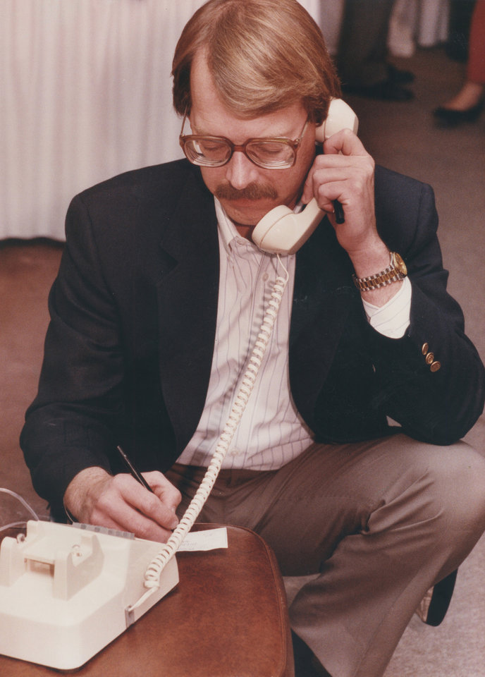 Photo - Dan Brown, chairman of STOP New Taxes, received updated voting figures on State Question 640 on March 10, 1992. [Photo by Jim Beckel, The Oklahoman Archives]