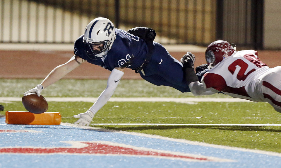 Photo - Regent Prep's Jack Wright (81) dives for a touchdown as Shattuck's Damien Gibson (28) defends during the Class B state championship football game between Shattuck and Regent Prep at Western Heights High School in Oklahoma City, Thursday, Dec. 6, 2018. Photo by Nate Billings, The Oklahoman