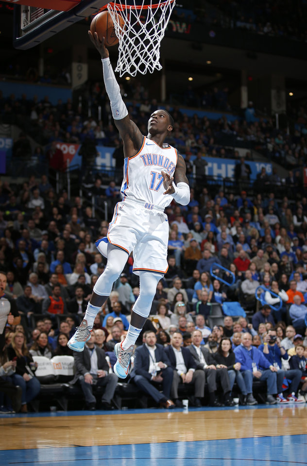 Photo - Oklahoma City's Dennis Schroder (17) goes up for a lay up during the NBA basketball game between the Oklahoma City Thunder and the Portland Trail Blazers at Chesapeake Energy Arena in Oklahoma City, Tuesday, Jan. 22, 2019. Photo by Sarah Phipps, The Oklahoman