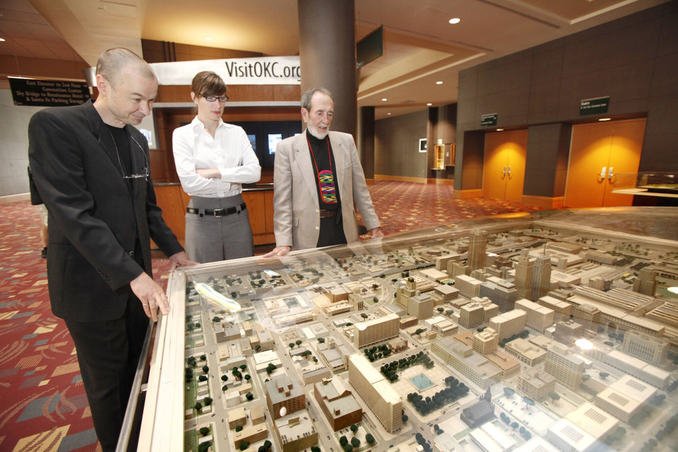 Photo - Hans Butzer, left, Rachel Mosman and Arn Henderson look at the I.M. Pei Model of Oklahoma City, Oklahoma April 30 , 2010. Photo by Steve Gooch, The Oklahoman ORG XMIT: KOD