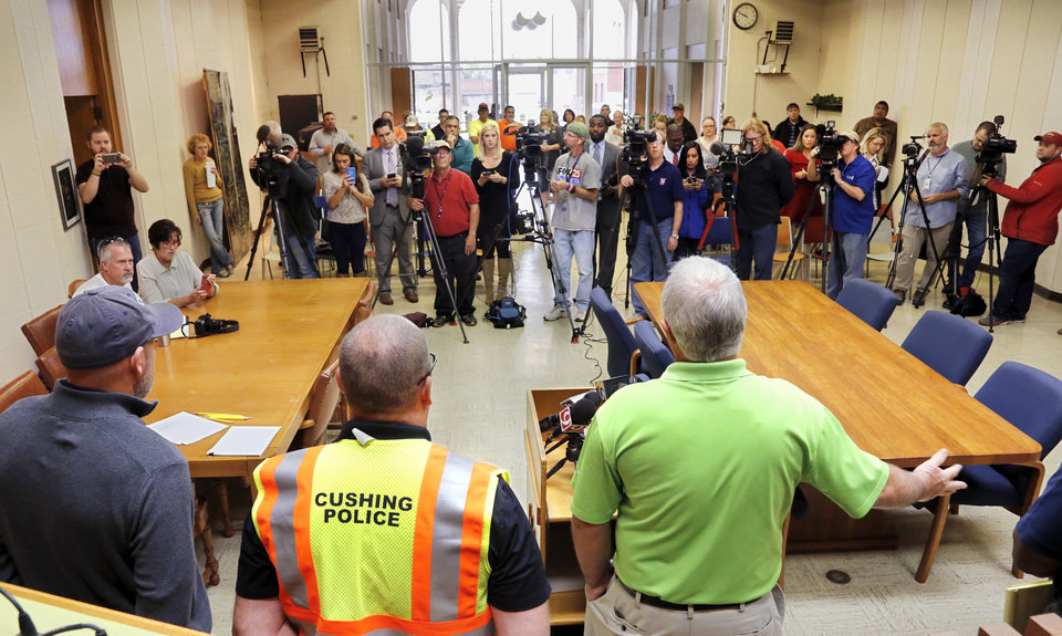 Photo - City officials provide damage updates to the media at a morning briefing at city hall. At podium, right,  is  City Manager Steve Spears. Beside him are Police Chief Tully Folden and Fire Chief Chris Pixler, left. Damage in downtown Cushing on Monday, Nov. 7, 2016, caused by Sunday night's 5.0 magnitude earthquake. Photo by Jim Beckel, The Oklahoman