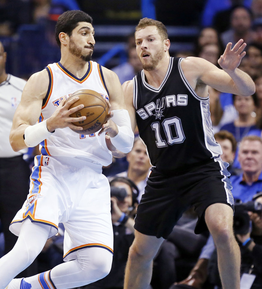Photo - Oklahoma City's Enes Kanter (11) works against San Antonio's David Lee (10) during an NBA basketball game between the Oklahoma City Thunder and San Antonio Spurs at Chesapeake Energy Arena in Oklahoma City, Friday, March 31, 2017. Photo by Nate Billings, The Oklahoman