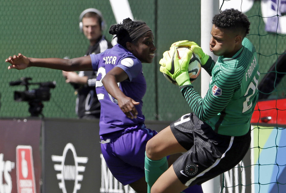 Photo - FILE - In this April 15, 2017, file photo, Portland Thorns goalie Adrianna Franch, right, stops a scoring attempt by Orlando Pride forward Jasmyne Spencer during the second half of their NWSL soccer match in Portland, Ore. The Thorns will host the third-place Pride in Portland on Saturday, Oct. 7, 2017, in their NWSL playoff semifinal game. (AP Photo/Don Ryan, file)