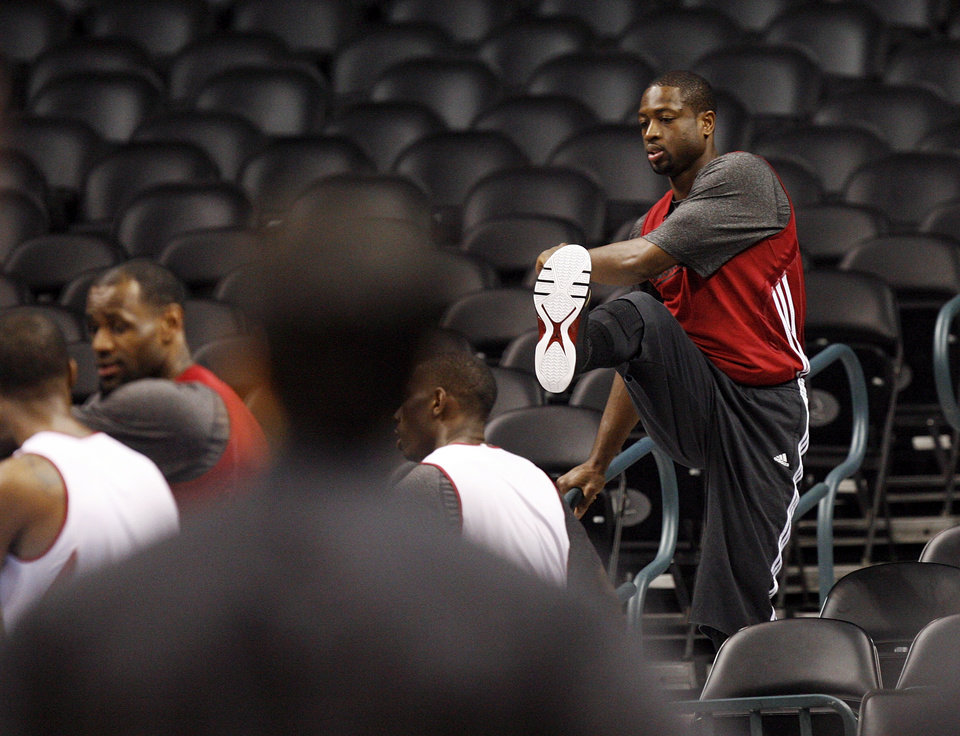 Photo - Miami's Dwyane Wade stretches in the stands during media and practice day for the NBA Finals between the Oklahoma City Thunder and the Miami Heat at the Chesapeake Energy Arena in Oklahoma City, Monday, June 11, 2012. Photo by Nate Billings, The Oklahoman
