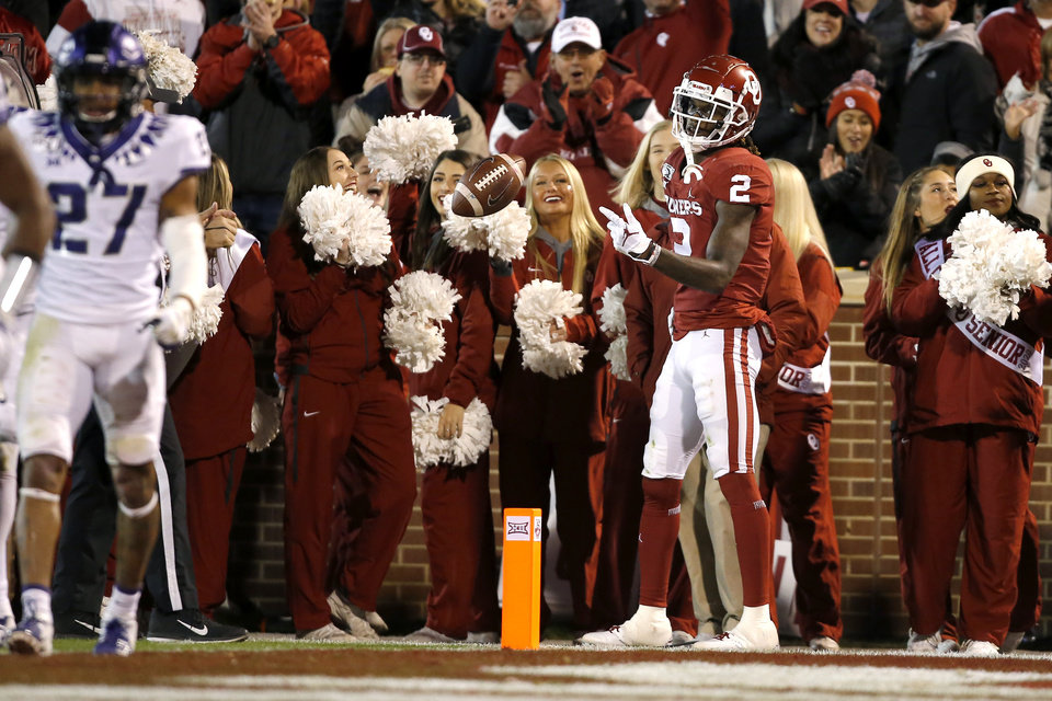 Photo - Oklahoma's CeeDee Lamb (2) celebrates after a touchdown during an NCAA football game between the University of Oklahoma Sooners (OU) and the TCU Horned Frogs at Gaylord Family-Oklahoma Memorial Stadium in Norman, Okla., Saturday, Nov. 23, 2019. [Bryan Terry/The Oklahoman]