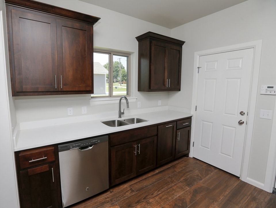 Photo -  This home at 1713 NE Euclid St. is part of an affordable housing program by Progress OKC. Shown here is the kitchen. [PHOTO BY NATE BILLINGS, THE OKLAHOMAN]