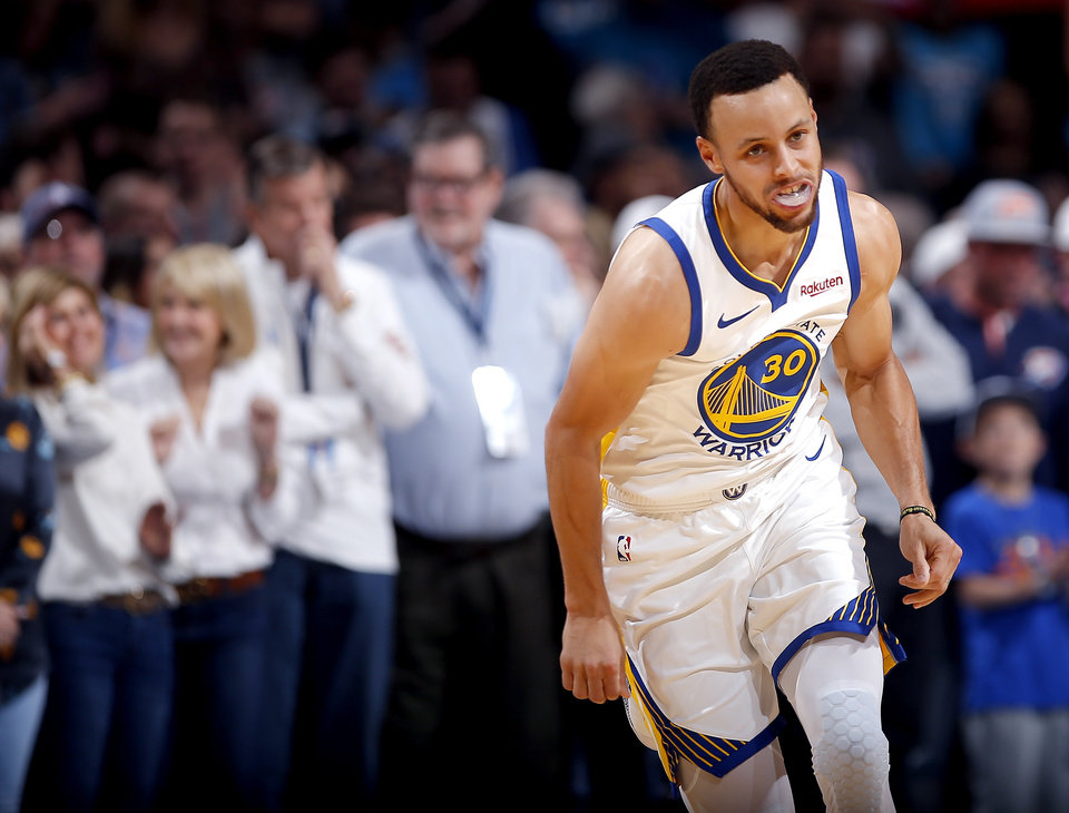 Photo - Golden State's Stephen Curry (30) reacts after a 3-point basket during the NBA basketball game between the Oklahoma City Thunder and the Golden State Warriors at Chesapeake Energy Arena,  Saturday, March 16, 2019. Photo by Sarah Phipps, The Oklahoman
