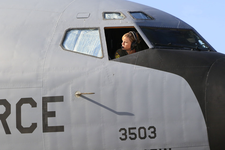 Photo -   Left:  Maj. Jenette Milburn prepares a KC-135 tanker from Tinker Air Force Base for a practice refueling mission. During the flight, the tanker rendezvoused with a B-52 bomber from Barksdale Air Force Base, which is near Bossier City, La.