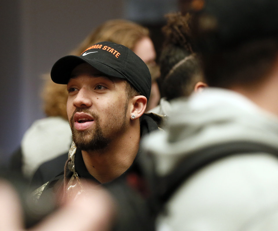 Photo - OSU quarterback Spencer Sanders waits for the start of an OSU football pep rally in the Student Union at Oklahoma State University in Stillwater, Okla., Tuesday, Jan. 21, 2020. [Nate Billings/The Oklahoman]