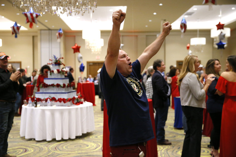 Photo - David Harris celebrates as he watches election results during a Republican Party election night watch party in Edmond, Tuesday, Nov. 3, 2020. [Bryan Terry/The Oklahoman]