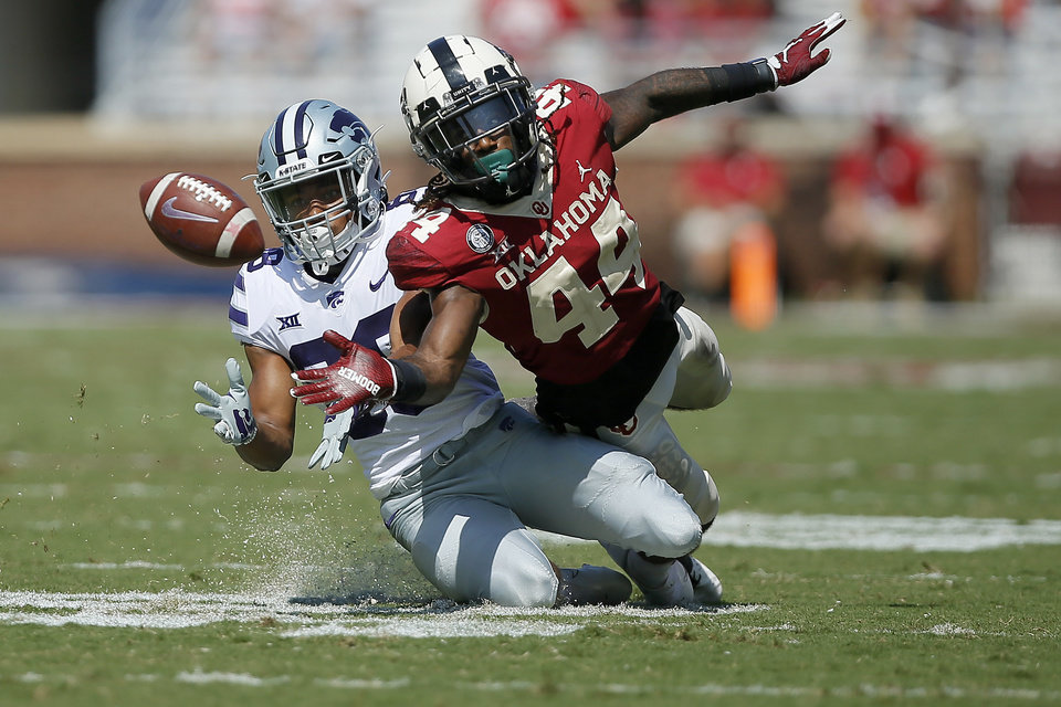 Photo - Oklahoma's Brendan Radley-Hiles (44) breaks up a pass intended for Kansas State's Phillip Brooks (88) during a college football game between the University of Oklahoma Sooners (OU) and the Kansas State Wildcats at Gaylord Family-Oklahoma Memorial Stadium in Norman, Okla., Saturday, Sept. 26, 2020. Kansas State won 38-35. [Bryan Terry/The Oklahoman]